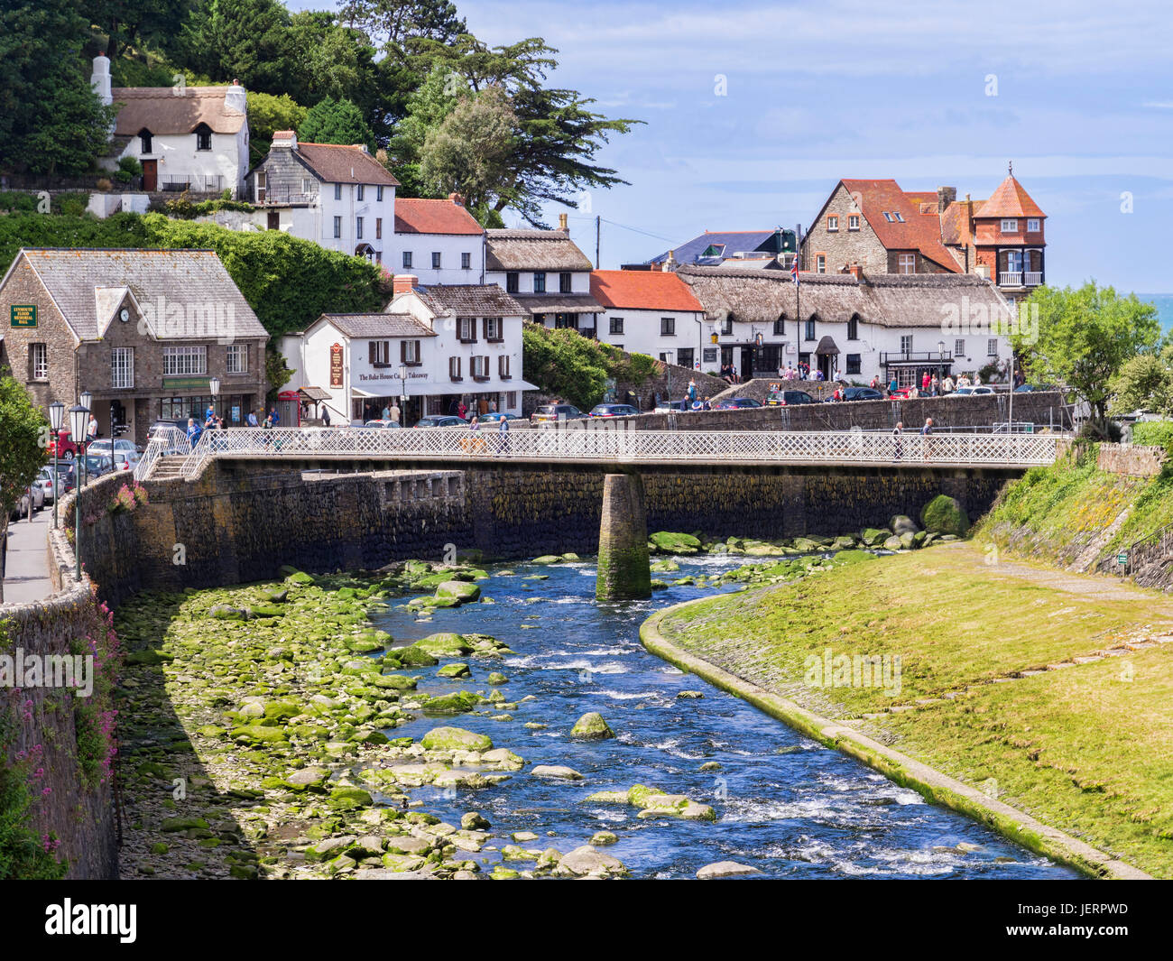 12 June 2017: Lynmouth, Devon, England, UK - A view of the River Lyn and Mars Hill on a sunny summer day at Lynmouth, - Stock Image