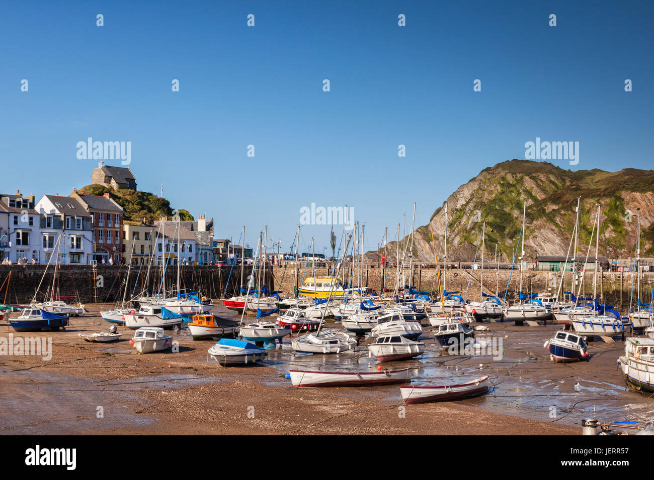 17 June 2017: Ilfracombe, North Devon, England, UK - The harbour at low tide on a sunny summer evening, with Hilldsborough - Stock Image