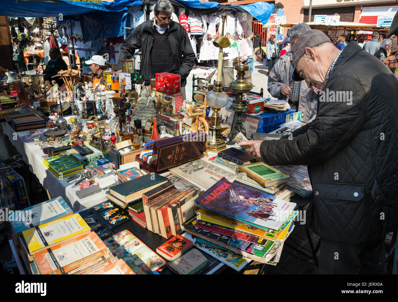 A stall in the Rastro flea market around Lavapies and Embajadores in the centre of Madrid, Spain. - Stock Image