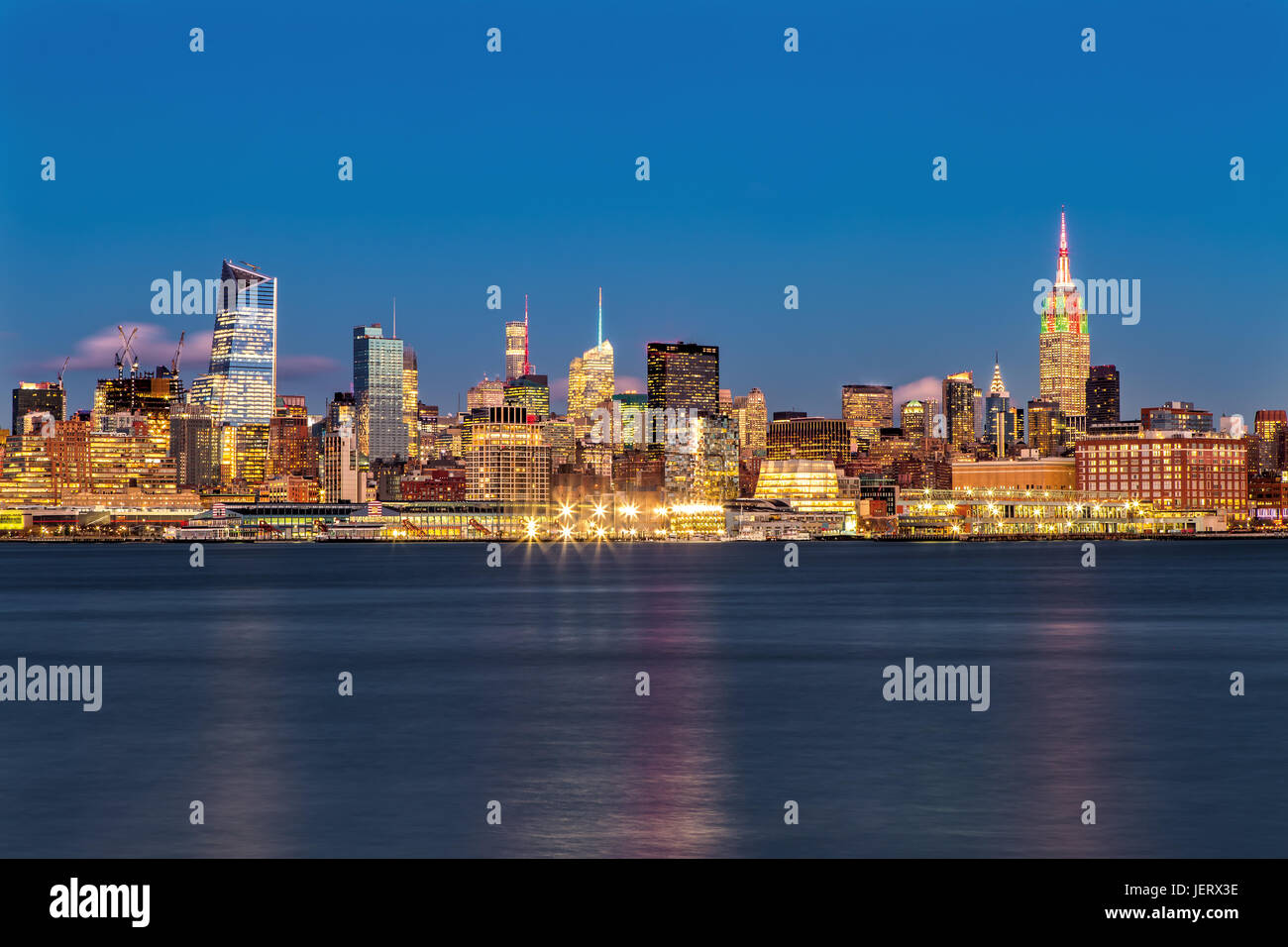 Empire State Building and Midtown Manhattan at Night - Stock Image