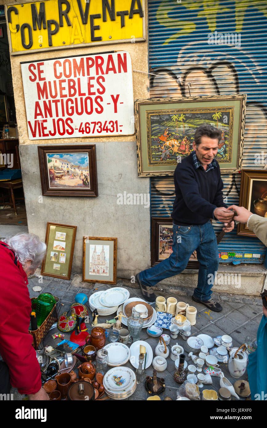 Pavement stalls in the Rastro flea market around Lavapies and Embajadores in the centre of Madrid, Spain. - Stock Image