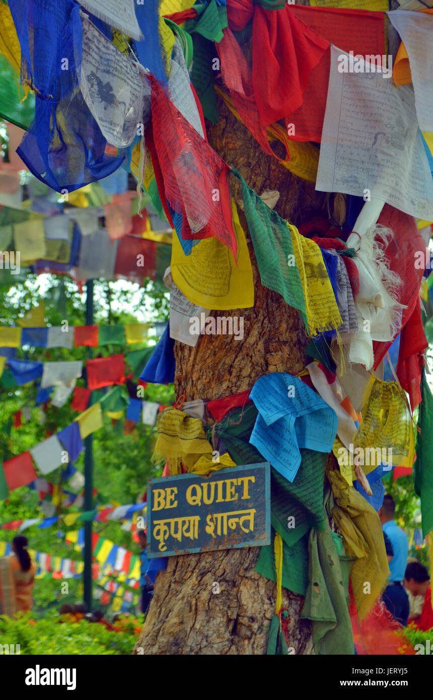 Be quiet - placard with a call for silence on Bodhi tree - a place of Buddha enlightenment. - Stock Image