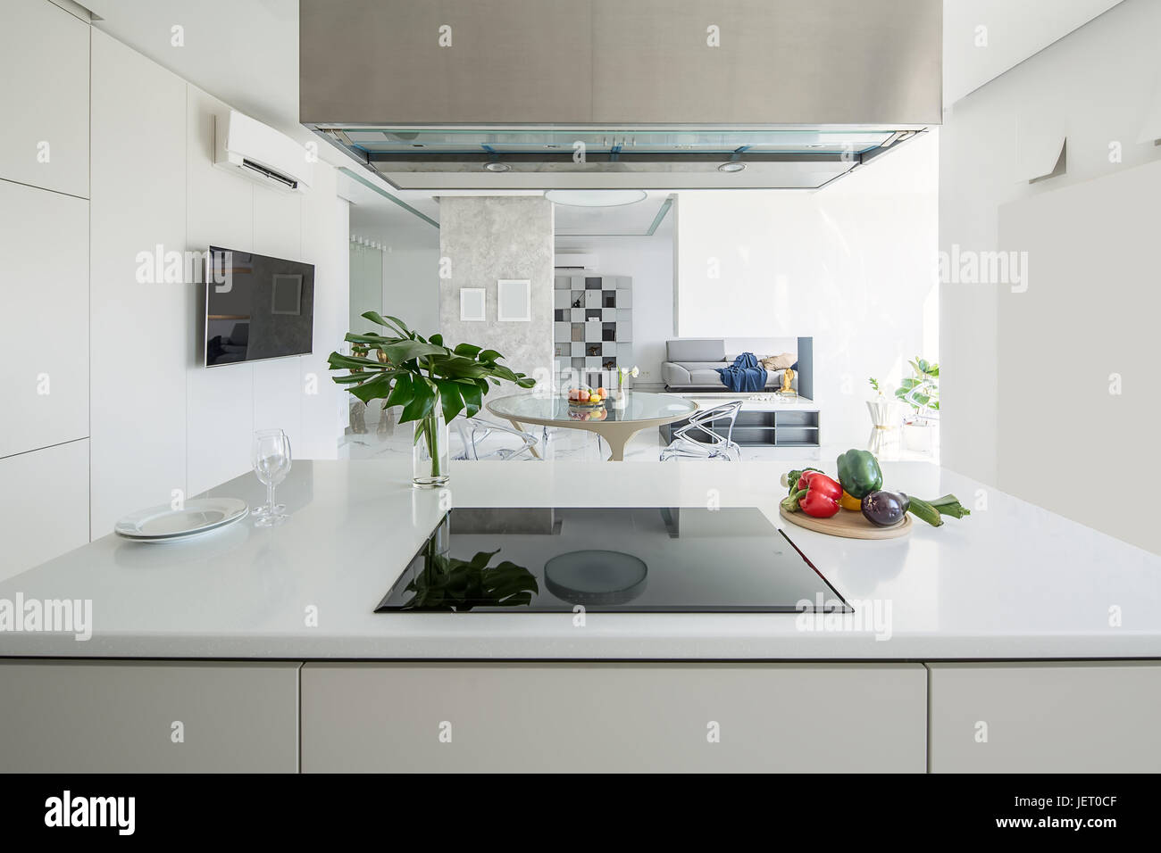 Light Kitchen Island With A Stove And A Kitchen Hood On The Stock