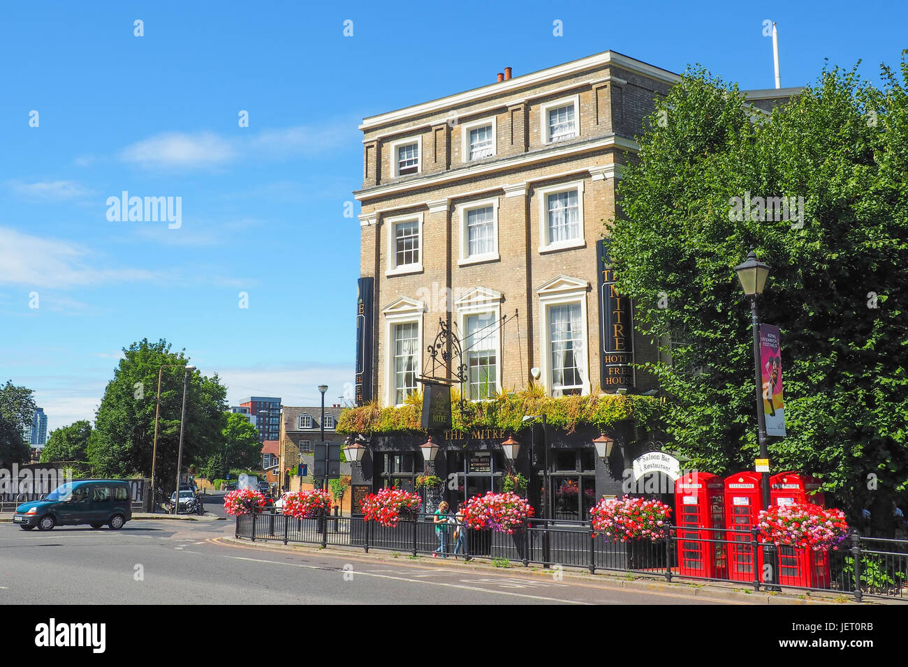 View of the Mitre Hotel and Pub in Greenwich, London in the summer day with unidentified people passing by and the - Stock Image