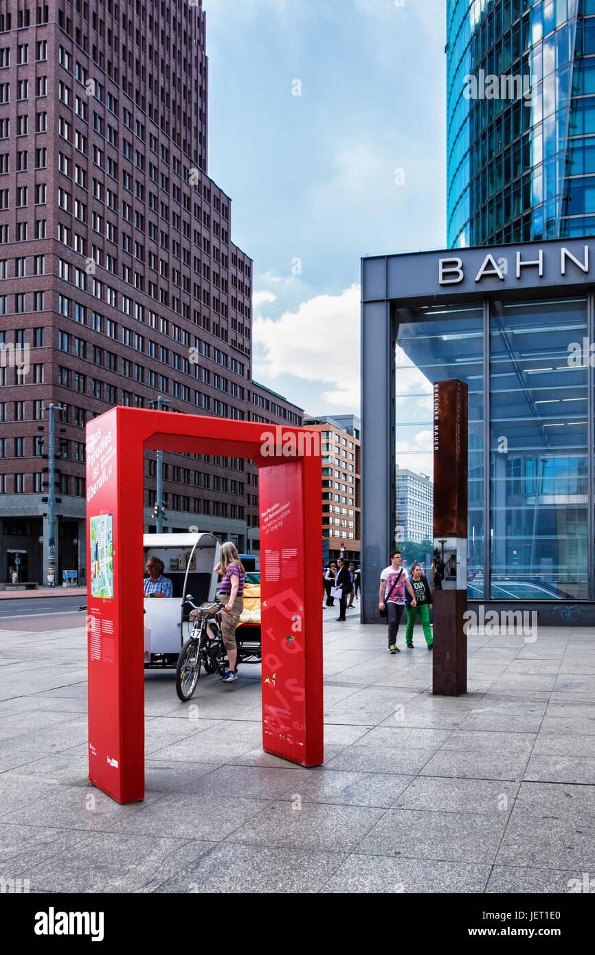 Berlin,Mitte.Potsdamer platz.Red arch marking a tourist popular spot, A paradise for Tourists,Das Touristen-Paradies - Stock Image