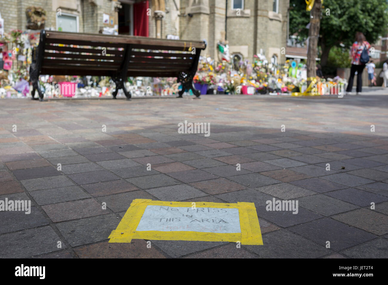Twelve days after the devastating fire that killed an unspecified number of people in Grenfell Tower, yellow tape - Stock Image