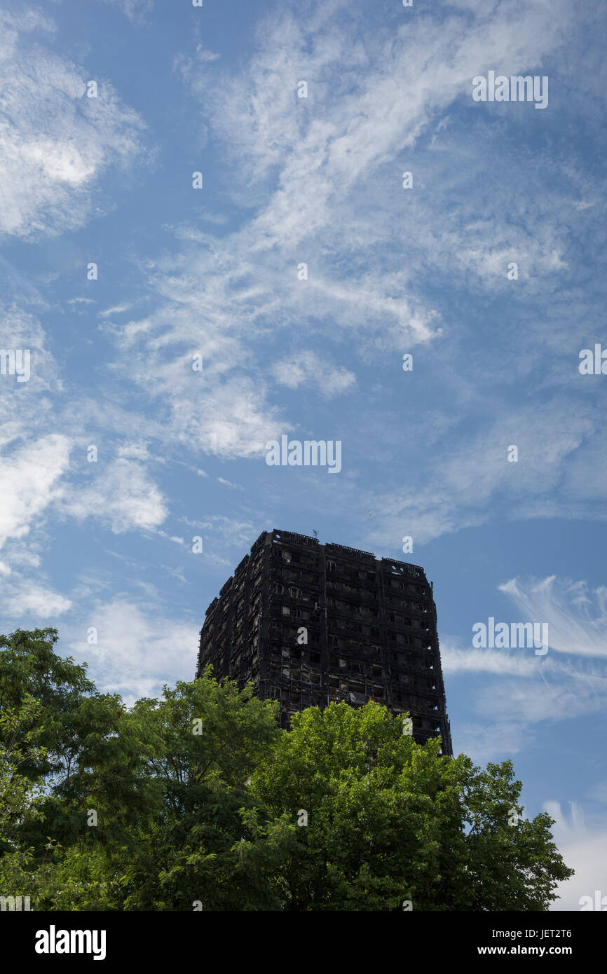Twelve days after the devastating fire that killed an unspecified number of people in Grenfell Tower, the charred Stock Photo