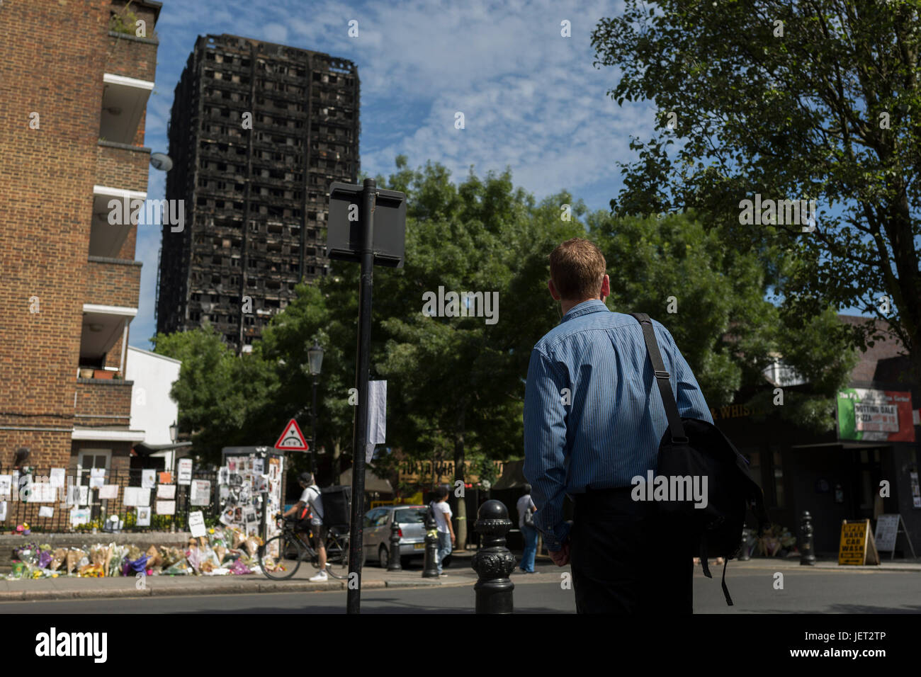Twelve days after the devastating fire that killed an unspecified number of people in Grenfell Tower, bystanders - Stock Image