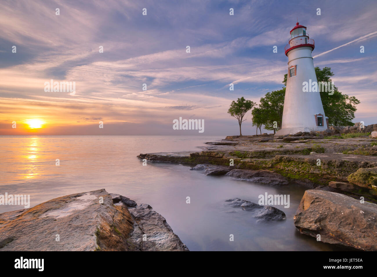 The Marblehead Lighthouse on the edge of Lake Erie in Ohio, USA. Photographed at sunrise. - Stock Image