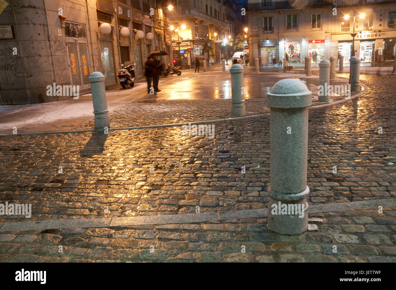 Wet and snow covered pavement, night view. Puerta del Sol, Madrid, Spain. Stock Photo