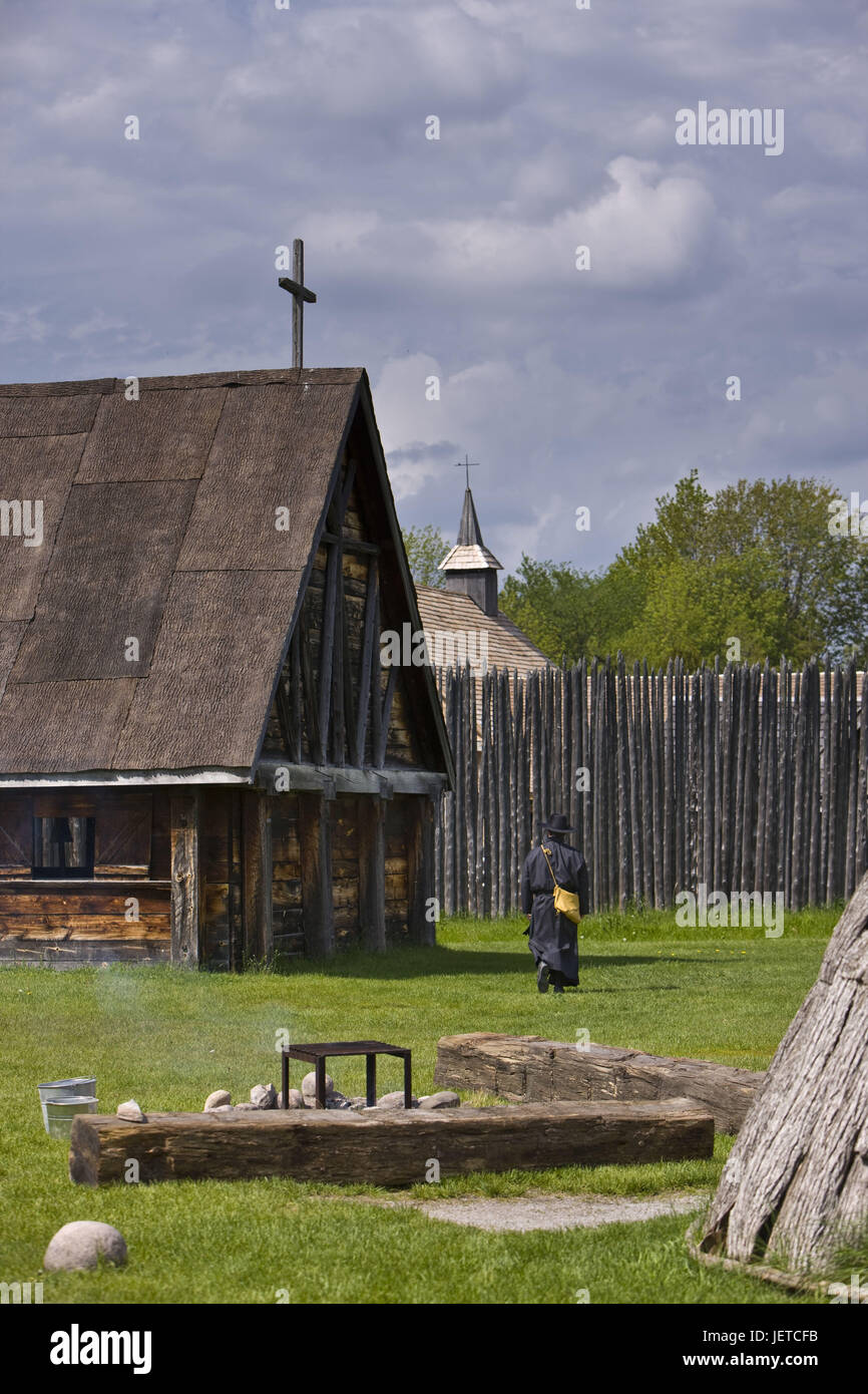 Canada, Ontario, Midland, Sainte-Marie among the Hurons, timber houses, churches, man, go, back view, no model release, - Stock Image