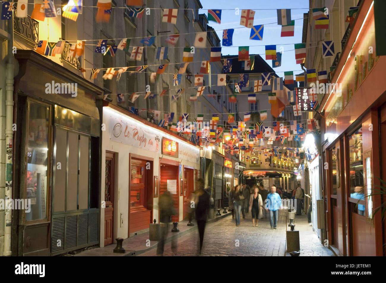 France, Paris, Rue de Laplander, decoration, pendant, pedestrian, blur, no model release, - Stock Image