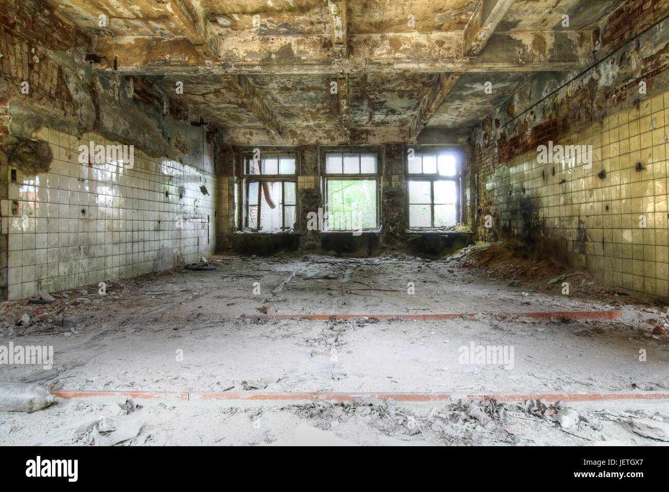 Ruins - broken and devasted interior of industry building - Stock Image