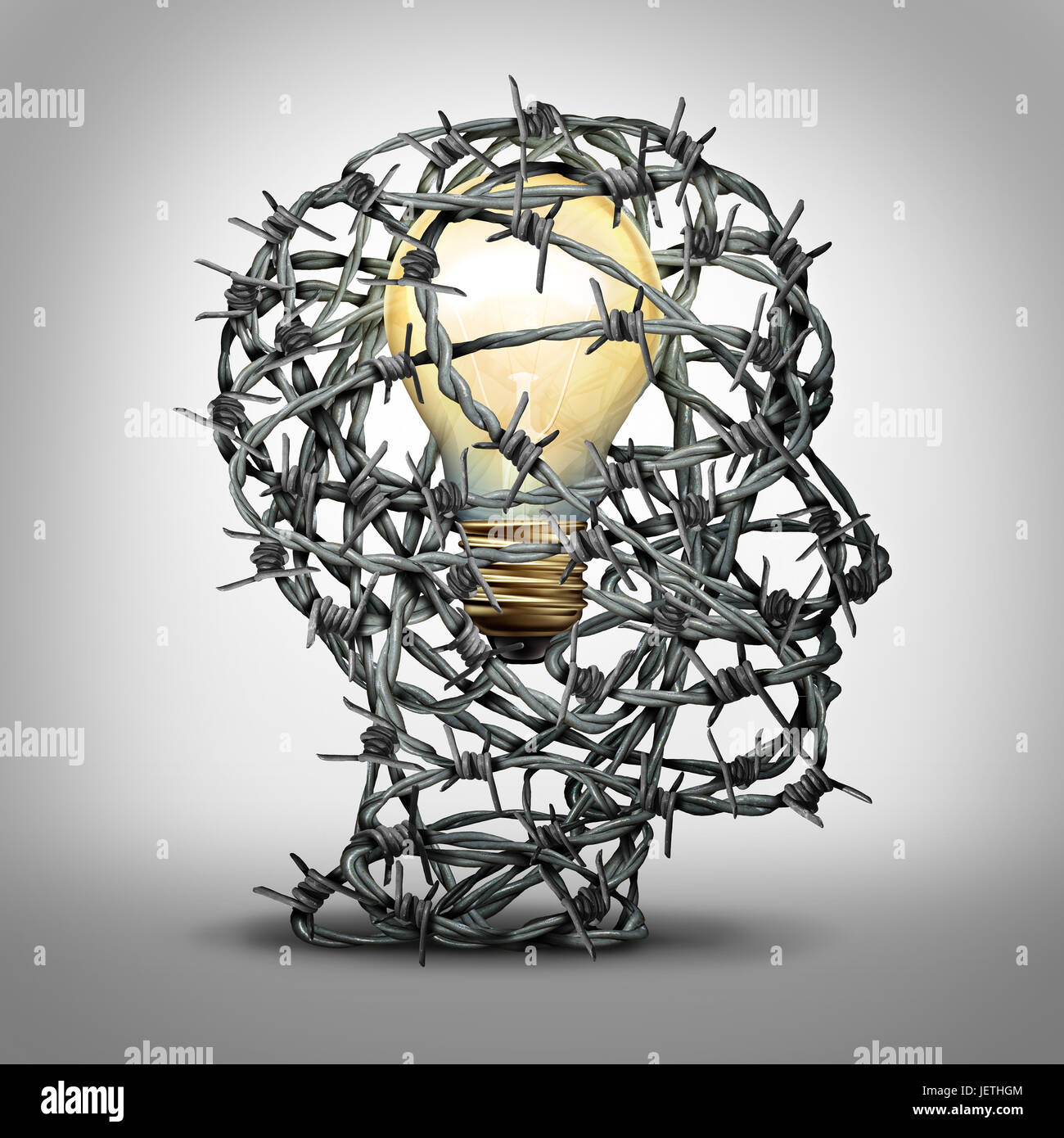 Protect your idea business thinking concept as a group of barbed wire shaped as a human head with an illuminated - Stock Image