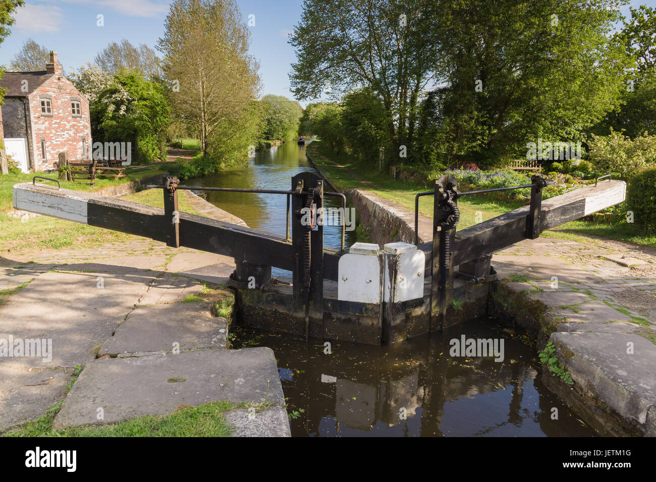 Canal lock gates at New Marton on the Shropshire Union canal in England UK used for raising narrowboats from upper Stock Photo