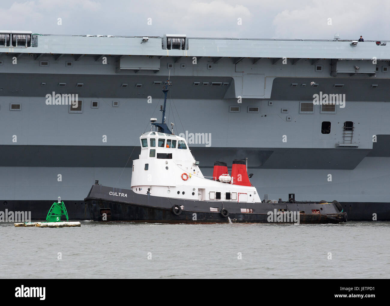Tugboats on the Firth of Forth towing the HMS Queen Elizabeth Aircraft carrier on the Firth of Forth Stock Photo
