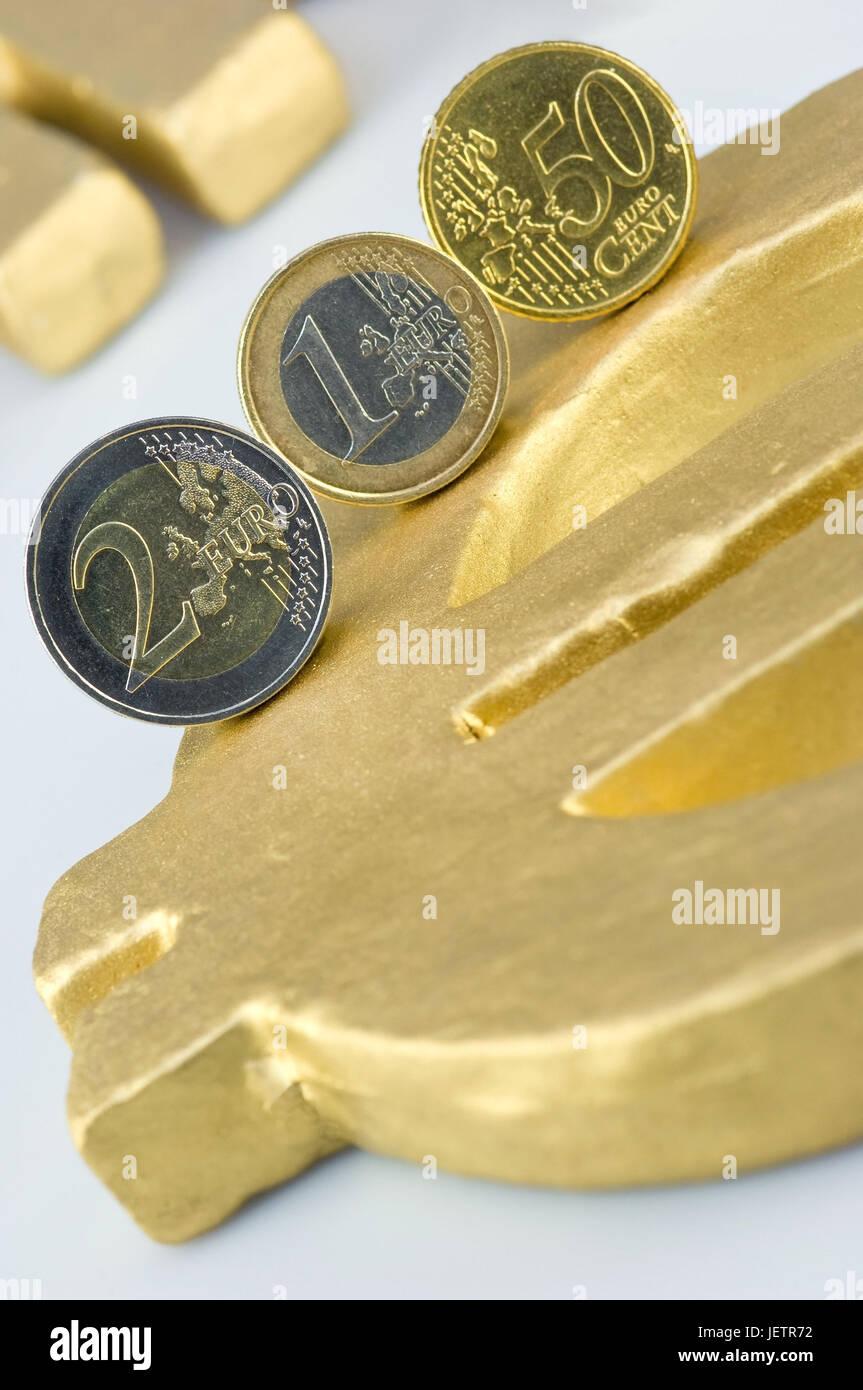 Eurocoins on eurosign, Euromuenzen auf Eurozeichen Stock Photo