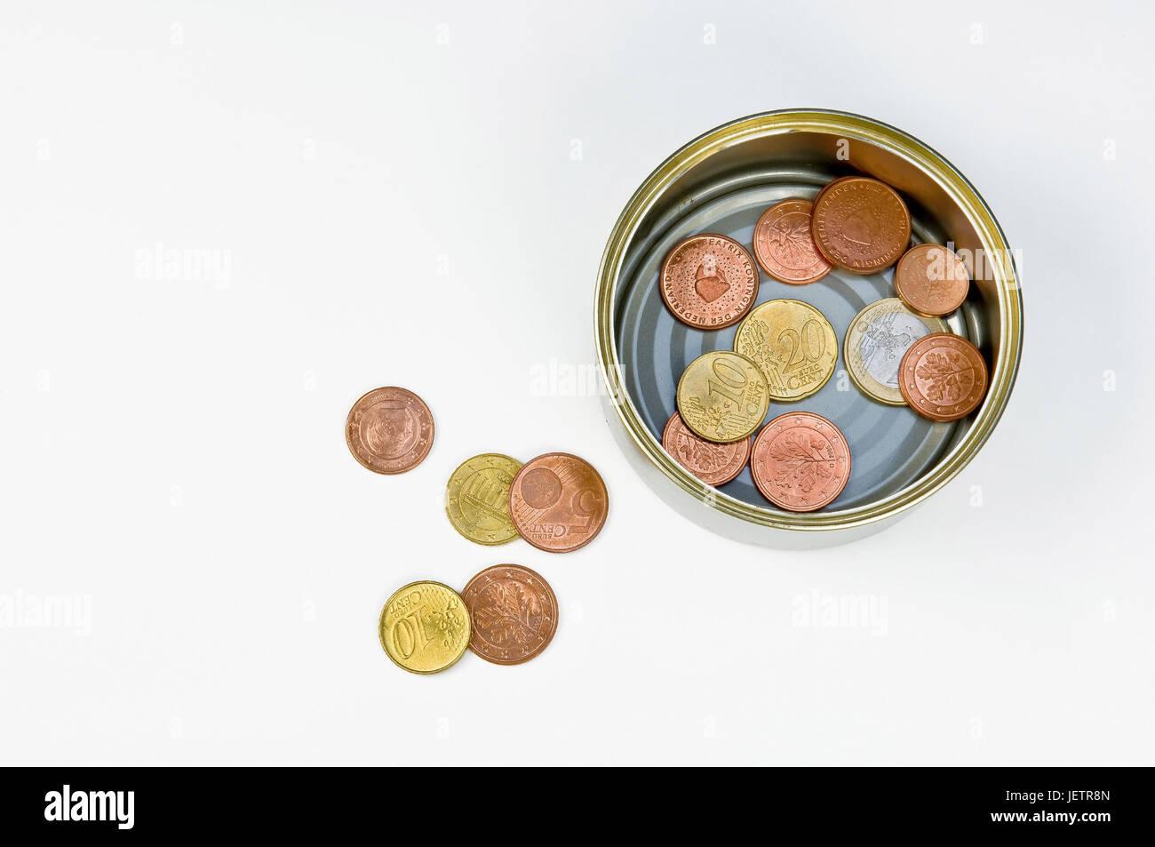 Canned food tin with coins, some are quite wrong, Konservendose mit Muenzen, einige liegen daneben - Stock Image