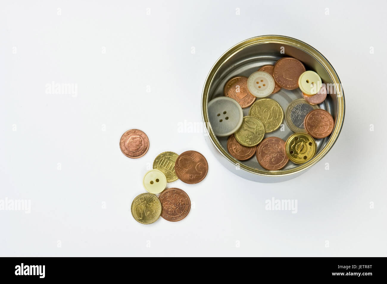 Canned food tin with coins and buttons, some are quite wrong, Konservendose mit Muenzen und Knoepfen, einige liegen - Stock Image