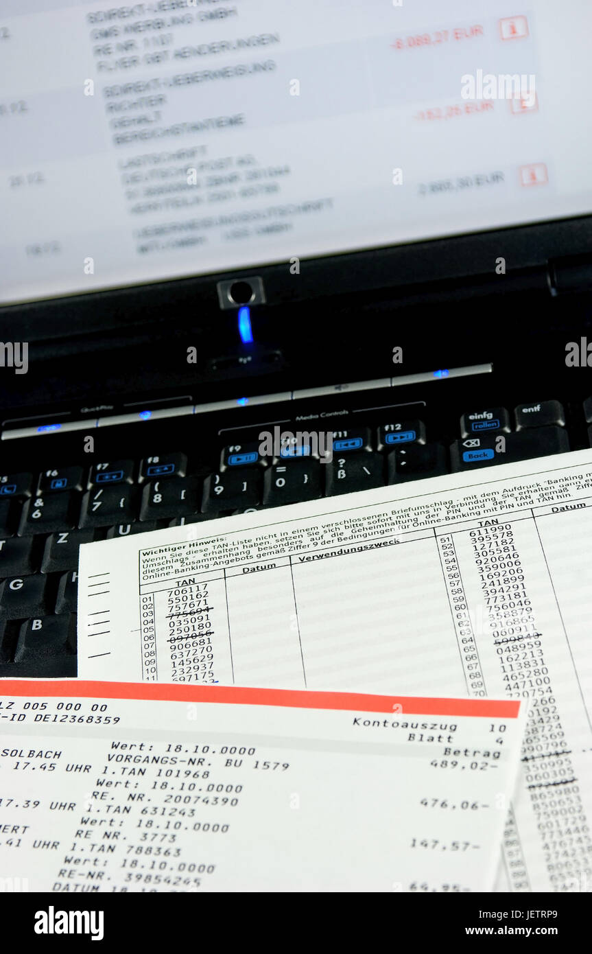 TAN list and bank statement on a PC keyboard recumbent, TAN-Liste und Kontoauszug auf einer PC-Tastatur liegend - Stock Image