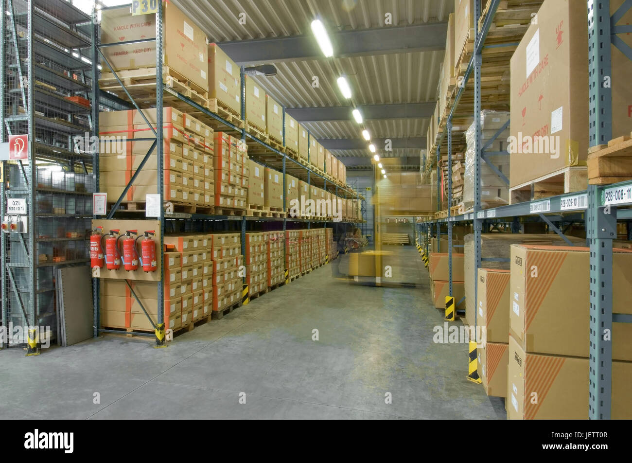 Automatic warehouse with forklift in Bewegungsunsch?rfe, Hochregallager mit Gabelstapler in Bewegungsunschaerfe Stock Photo