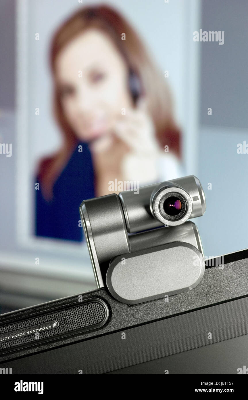Webcam on monitor, in the background a Screen with portrait of a woman, Webcam auf Monitor, im Hintergrund ein Screen - Stock Image