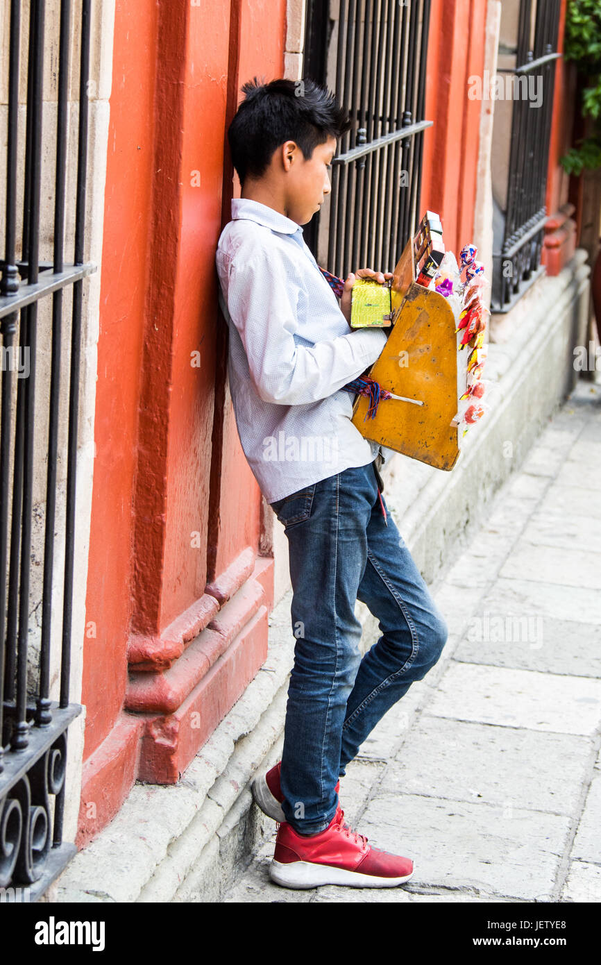 Boy selling candy on the street in Oaxaca, Mexico - Stock Image
