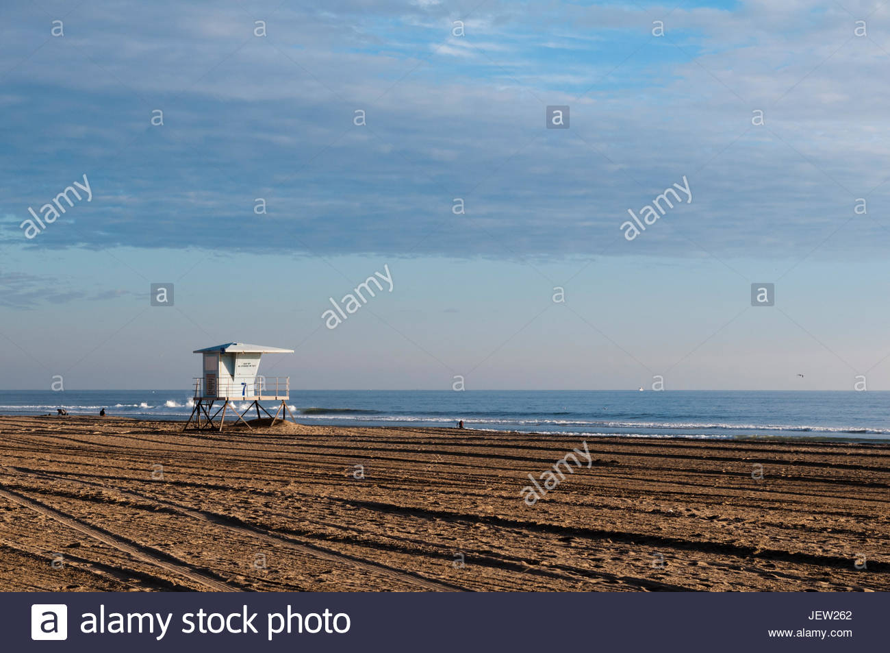 A life guard shack on almost deserted Huntington Beach, on the Pacific Ocean. - Stock Image