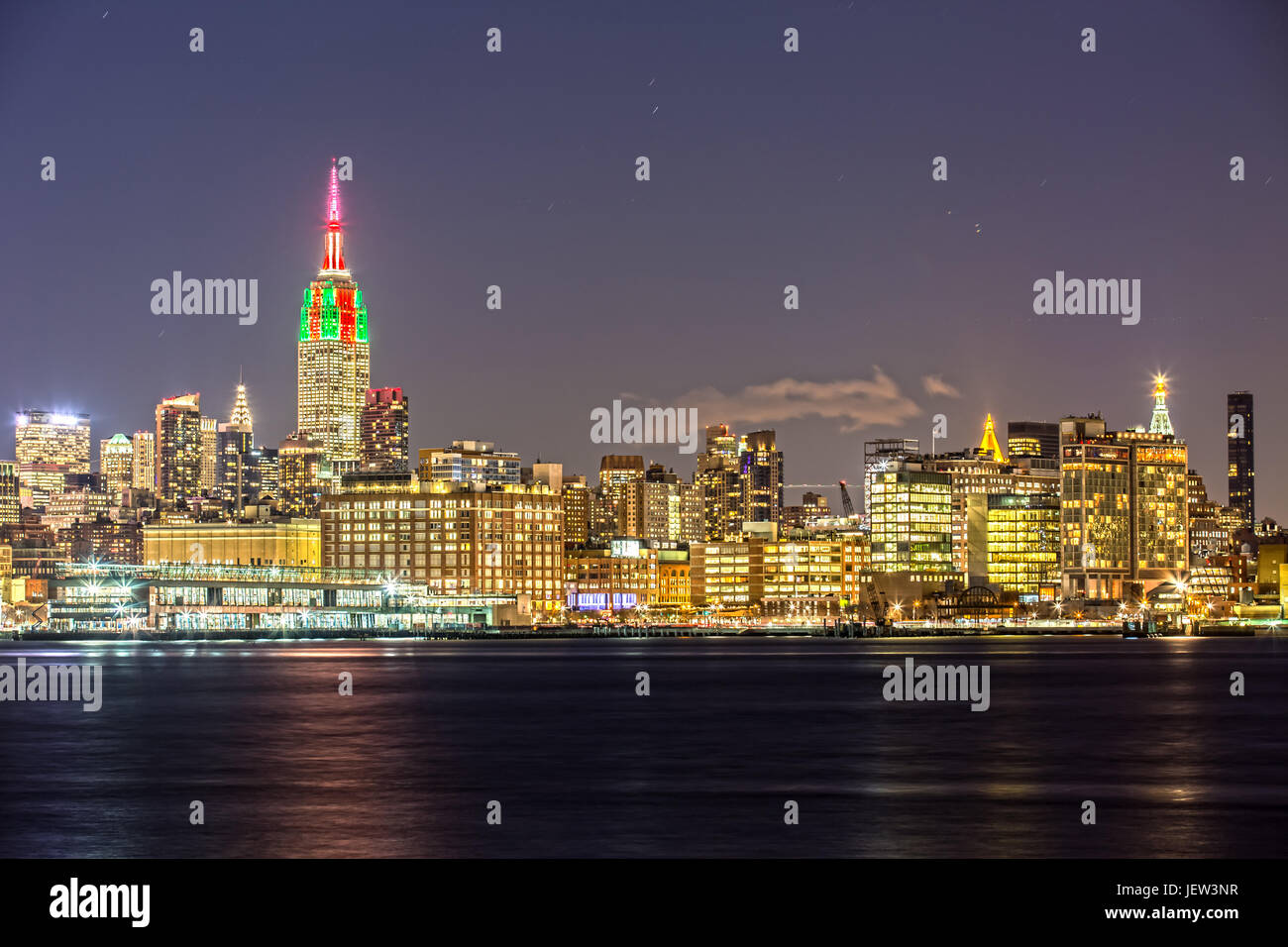 Empire State Building in New York with Skyline at Night - Stock Image