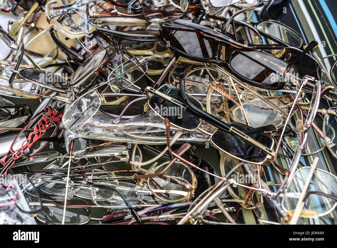 Copyrighted Image by Paul Slater/PSI - Unwanted Spectacles, Glasses to be recycled for World Glasses Day. - Stock Image