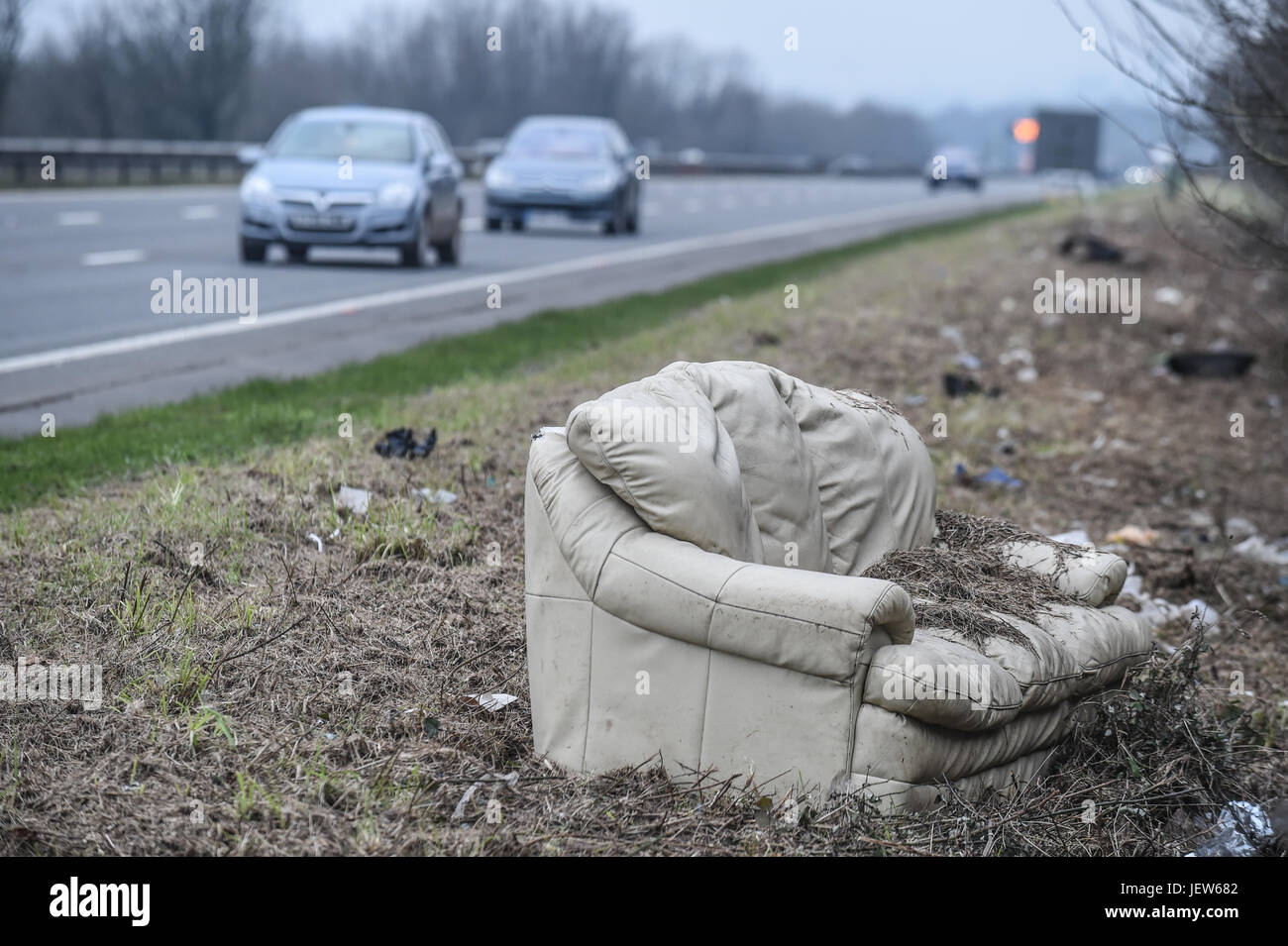 Copyrighted Image by Paul Slater/PSI - Dumped sofa on the side of the A38, Devon. - Stock Image