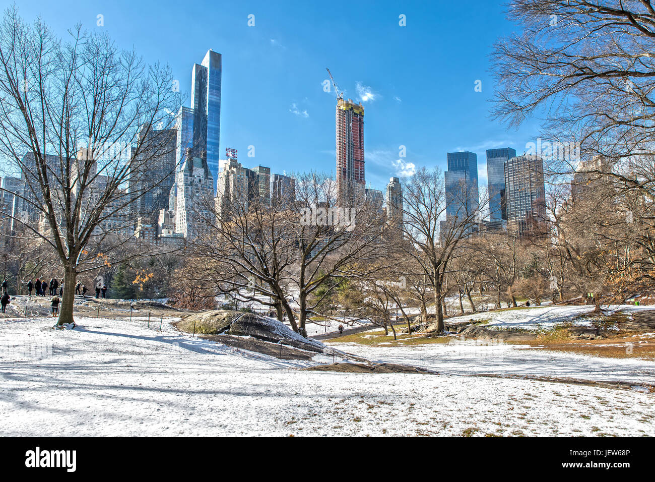 Central Park and Skyline in Winter with Ice Rink and Snow - Stock Image
