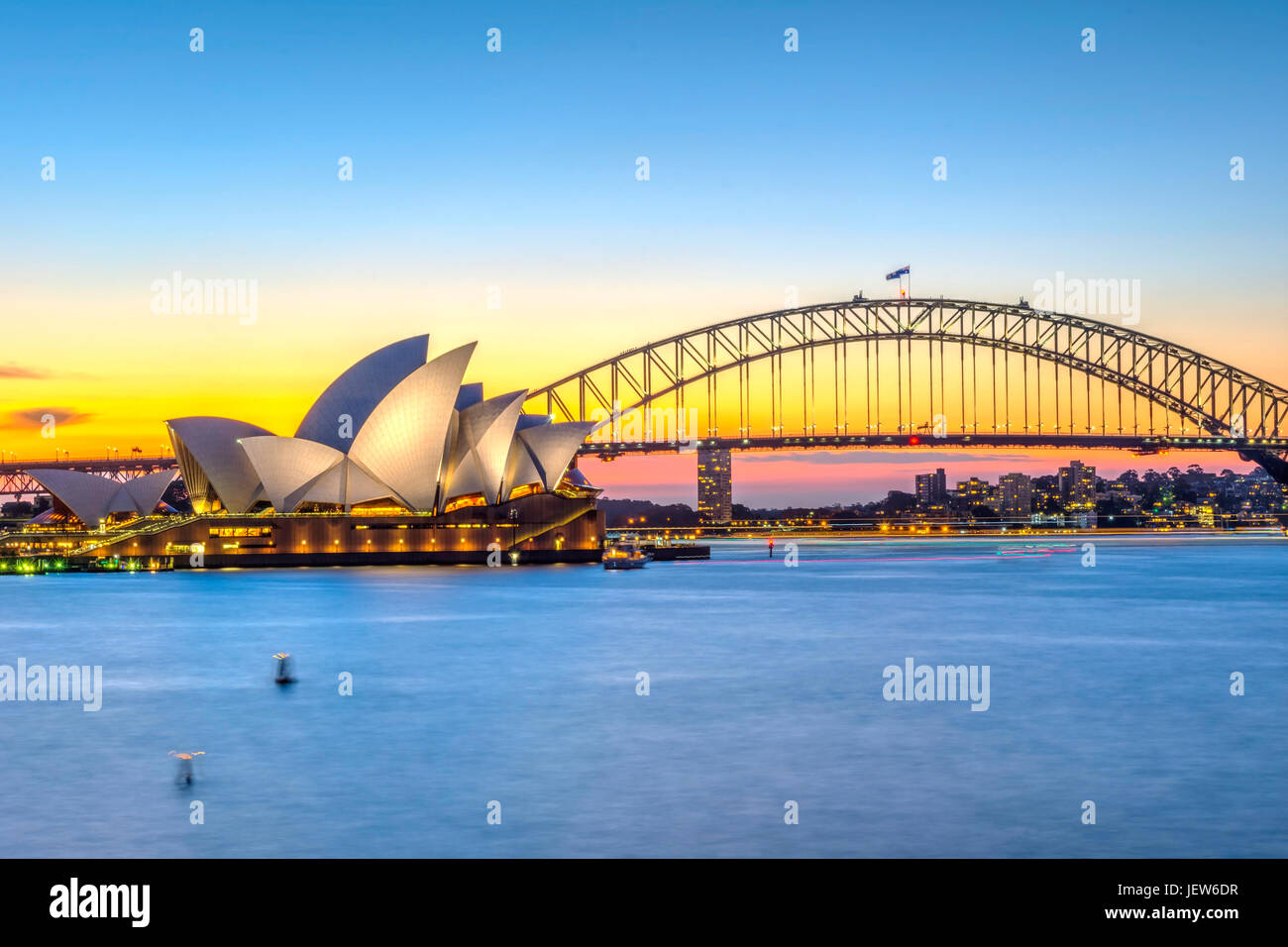 View on Sydney Opera house and harbour bridge at sunset - Stock Image