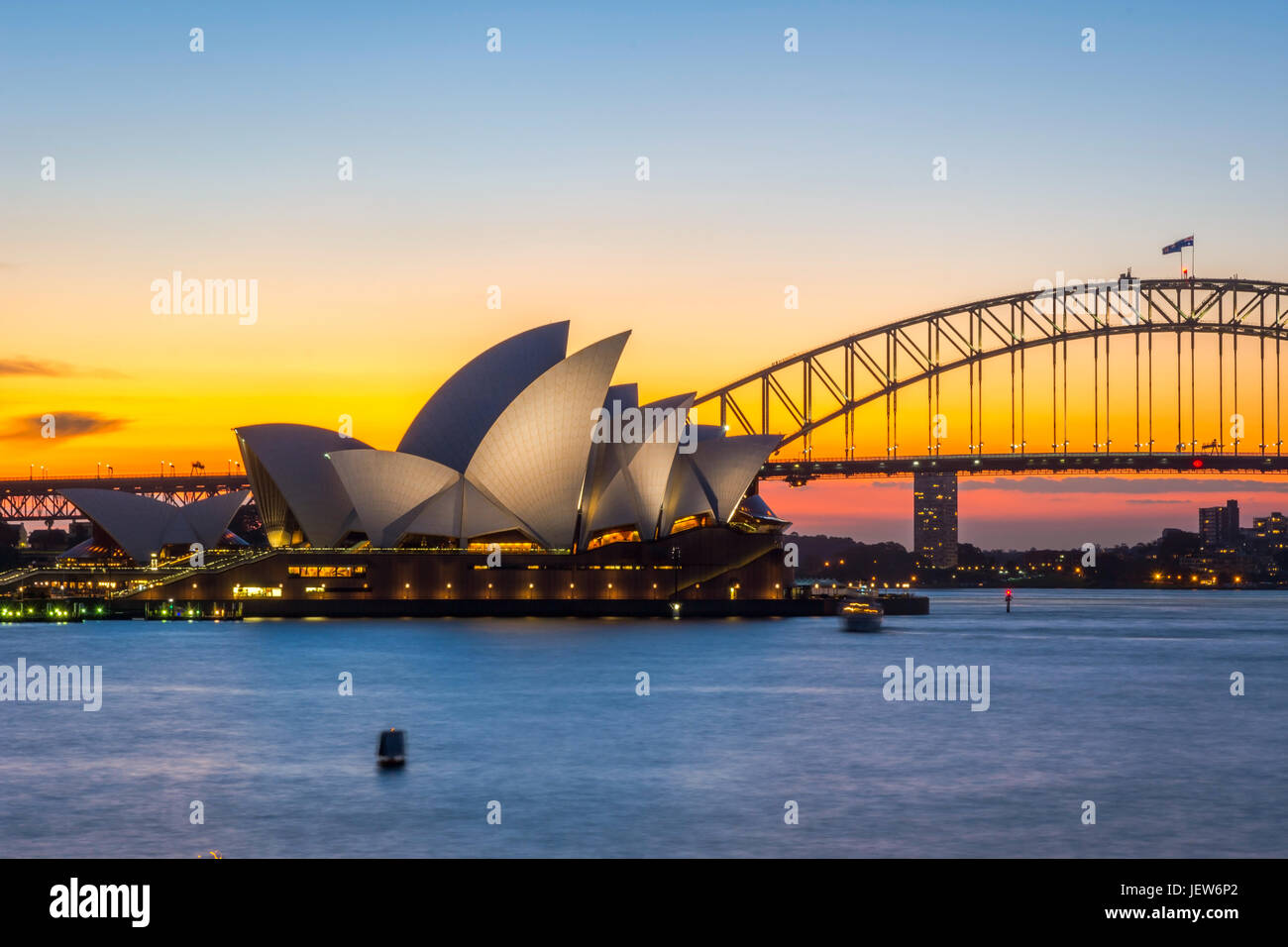 View on Sydney Opera house and harbour bridge at sunset Stock Photo