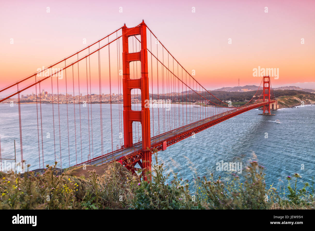 Golden Gate Bridge in San Francisco while the Sun is going down Stock Photo