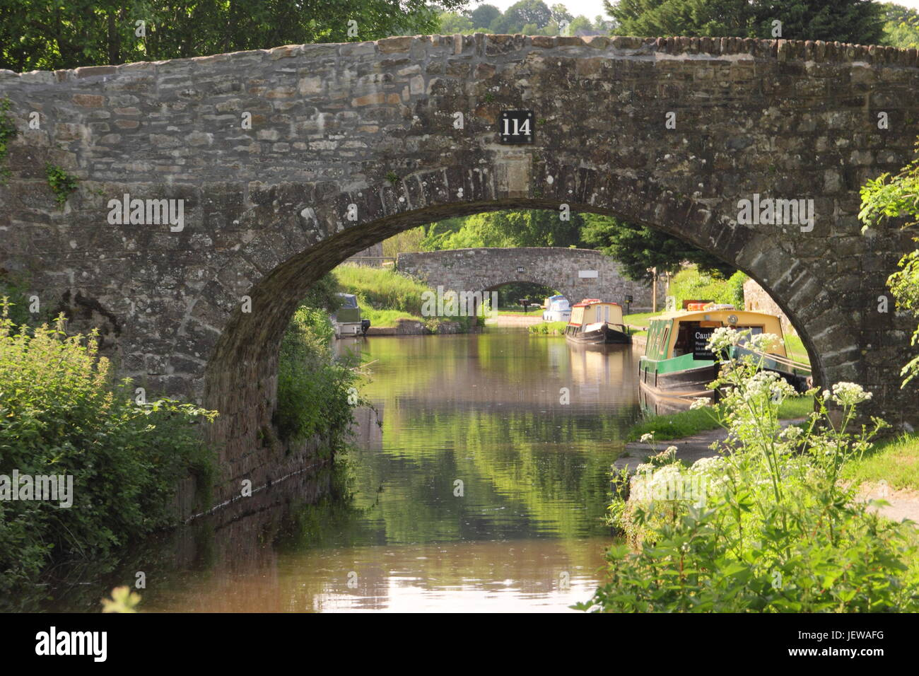 Narrowboats moored on the Monmouthshire and Brecon canal near Llangattock, Brecon Beacons, Powys, Wales -  June - Stock Image