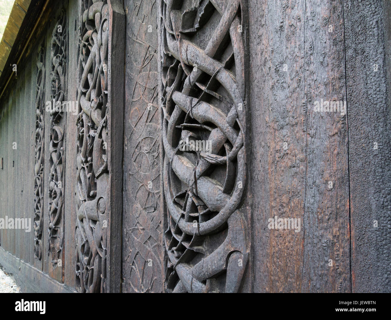 Iconography in old portal in Northern wall of Urnes old Stave church Ornes Luster Sogn og Fjordane county Norway - Stock Image