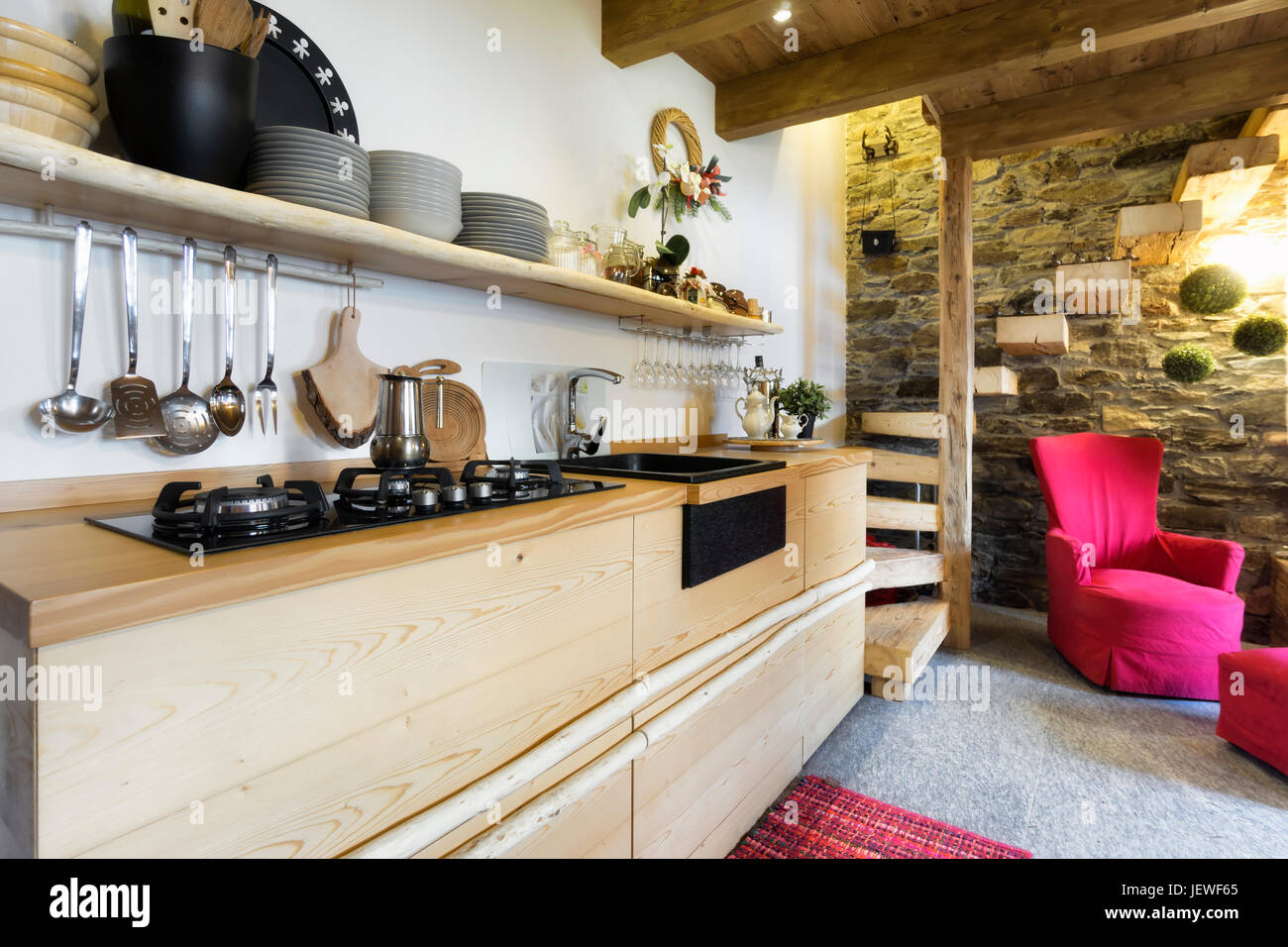 wooden kitchen in a country style cottage - Stock Image
