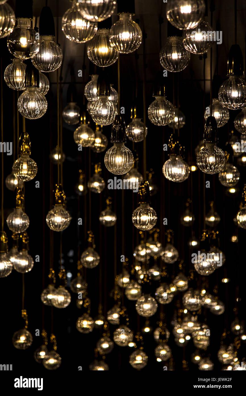 Light globes shining in the dark - Stock Image