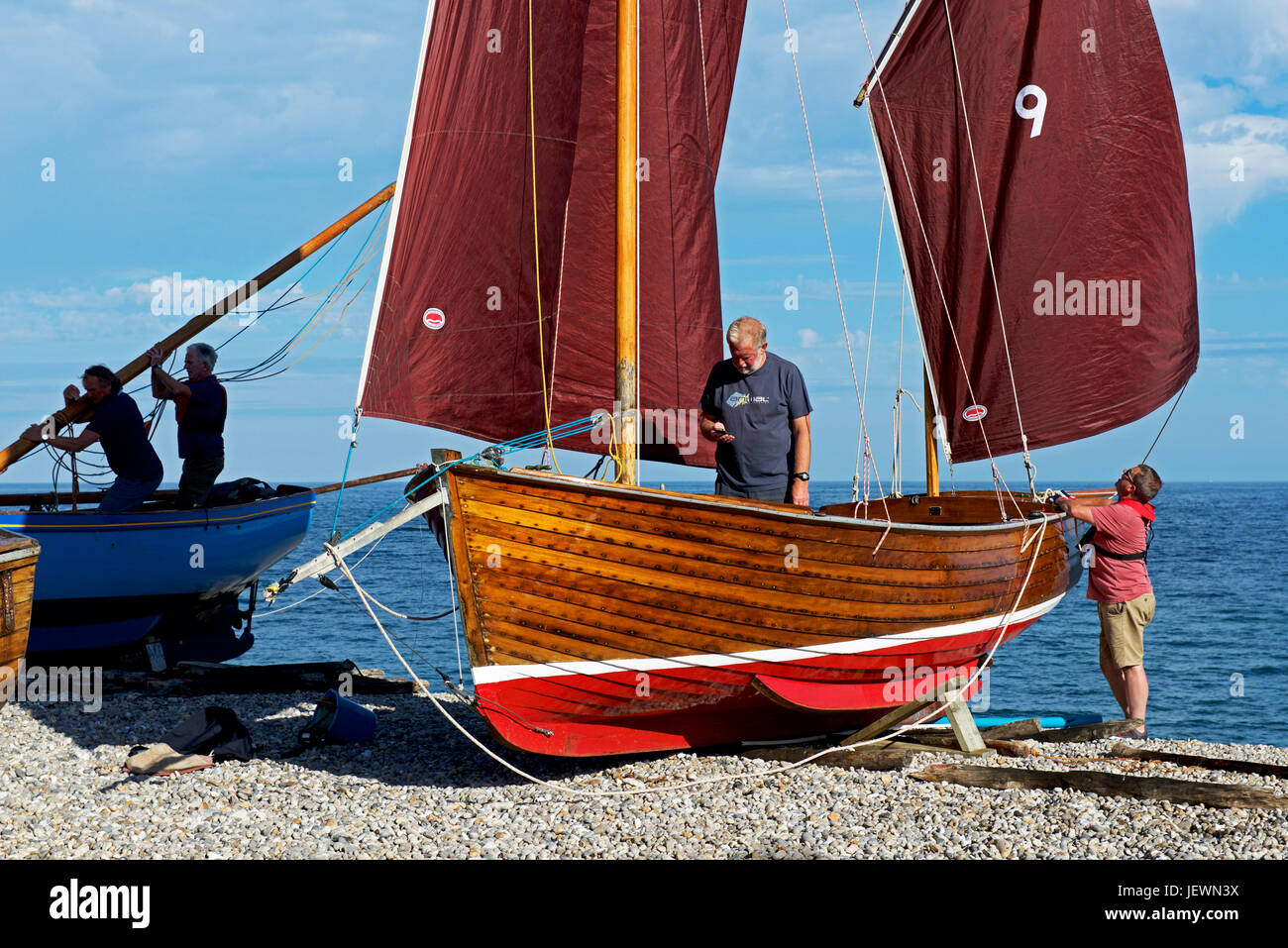 rigging boats (luggers) on the beach. Beer, Devon, England UK - Stock Image