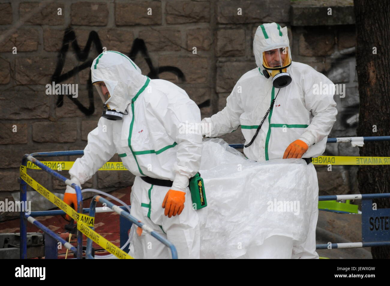 Decontamination specialists remove asbestos in a refugees camp, Lyon - Stock Image