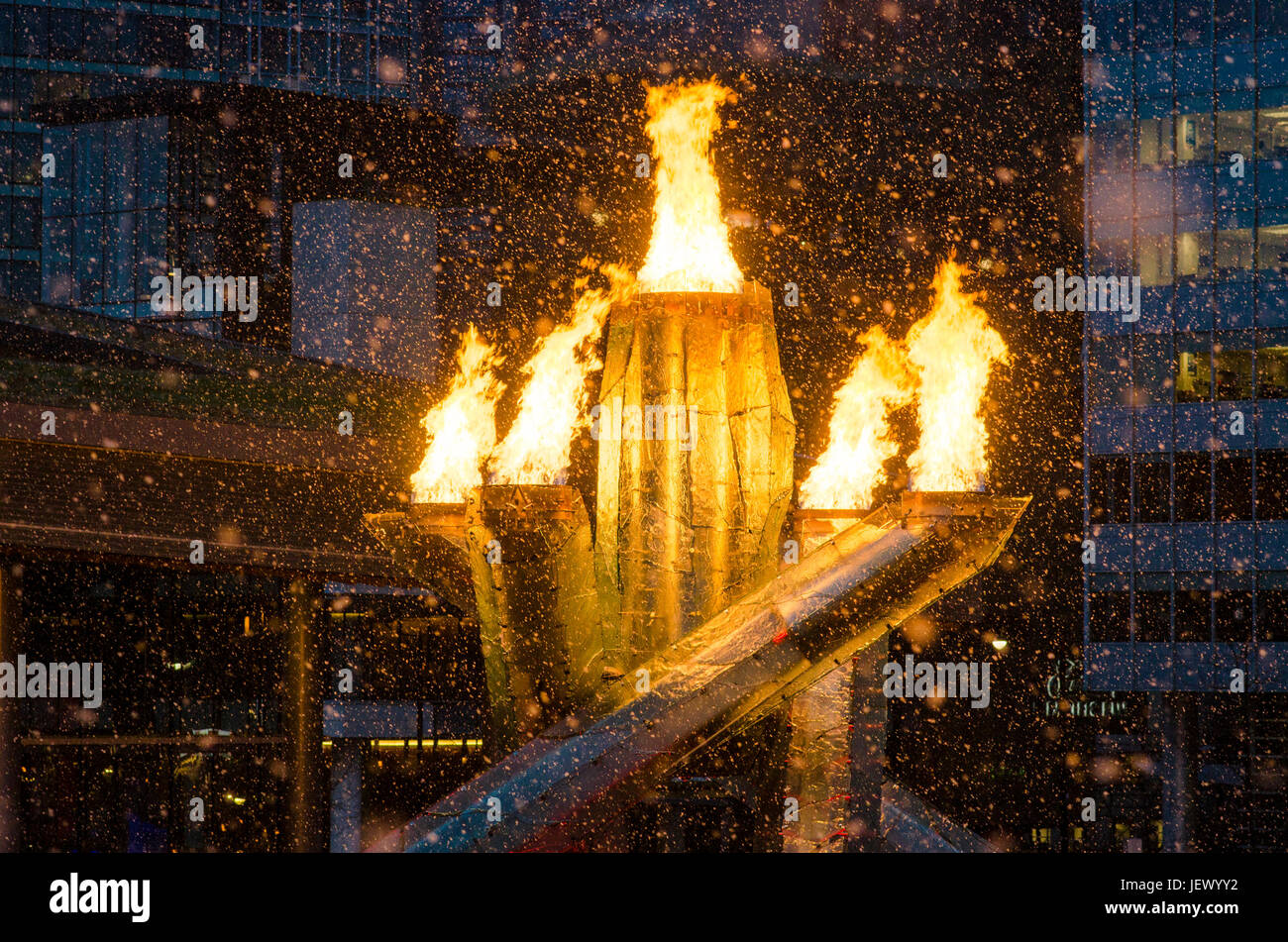 The Olympic Cauldron and flame during snowstorm, Vancouver, BC, Canada - Stock Image