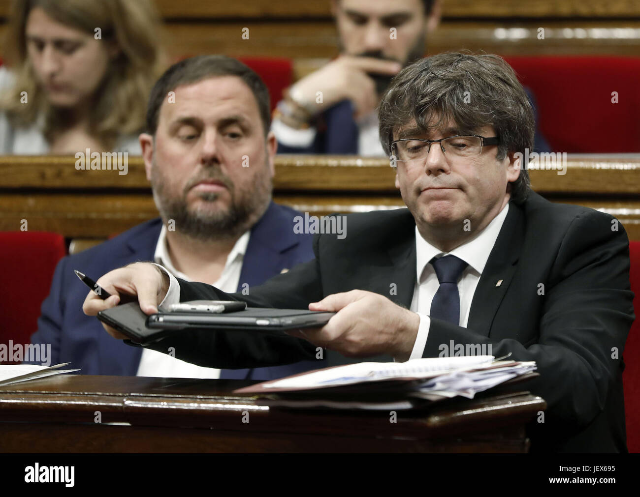 Catalonian regional president, Charles Puigdemont (R), attends question time at the regional Parliament in Barcelona, - Stock Image