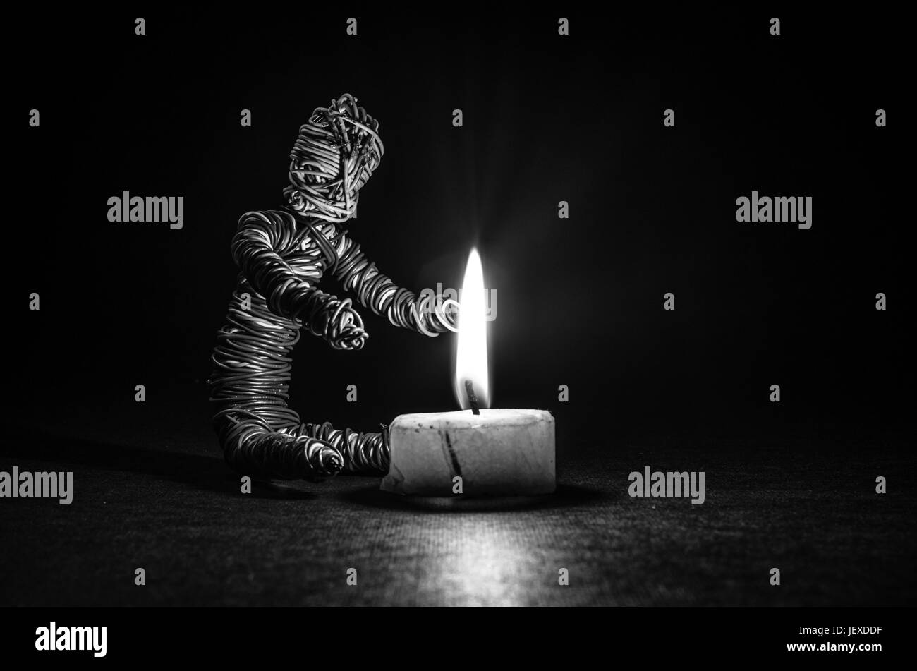 a small puppet getting warm - Stock Image