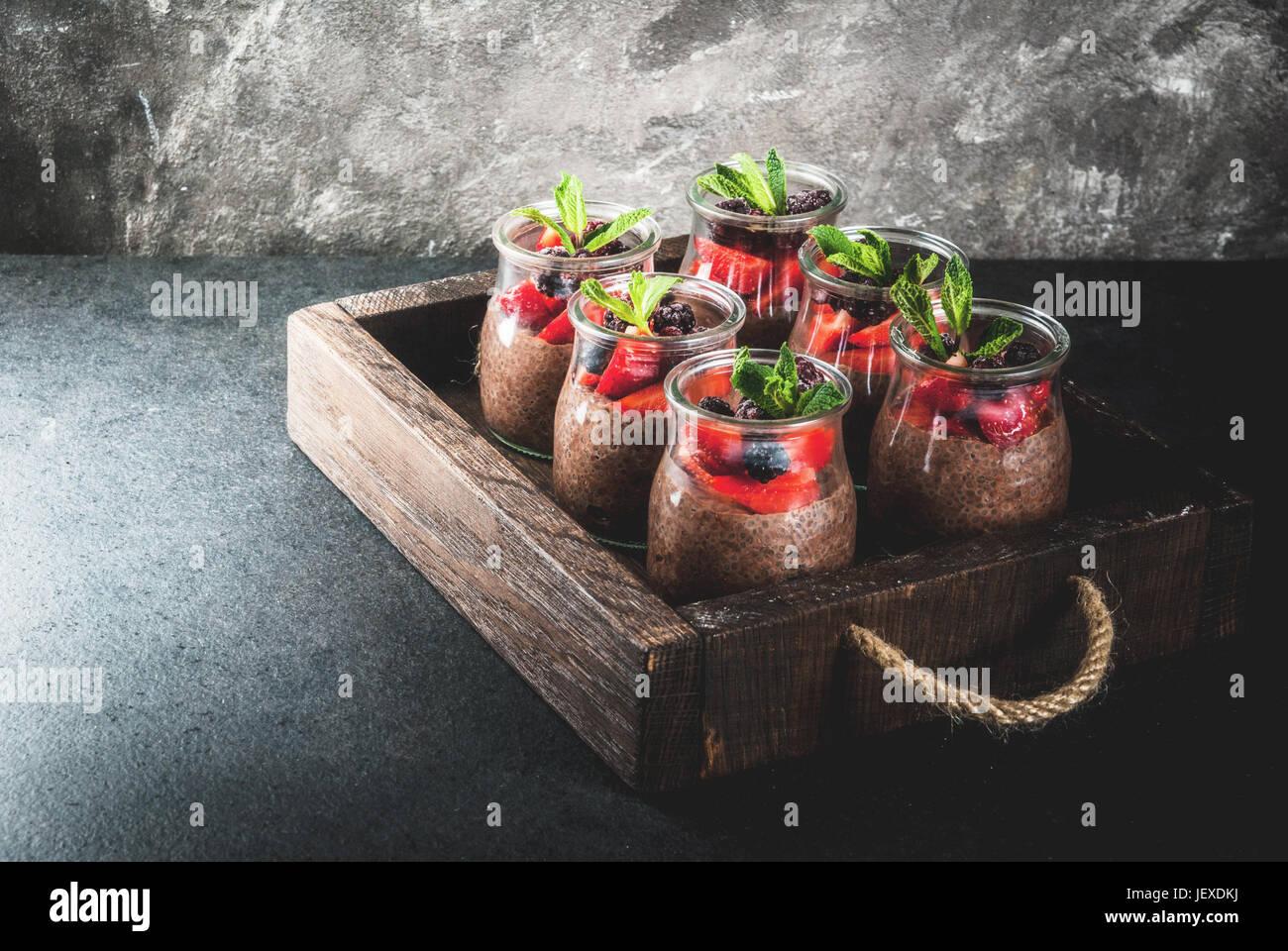 Healthy vegan breakfast. Dessert. Alternative food. Pudding with chia seeds, fresh strawberries, blackberries and - Stock Image