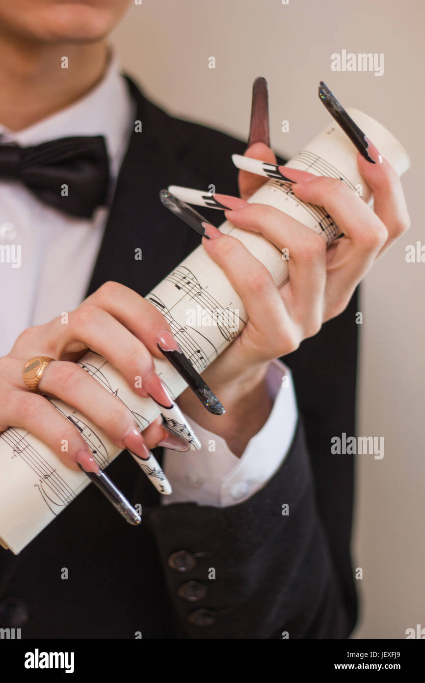musician with long nails Stock Photo: 146871153 - Alamy