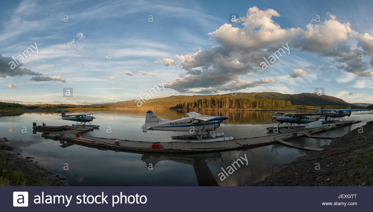 Float plane dock the morning of the start of the expedition. Thousands of tourists travel every year to the Peel - Stock Image