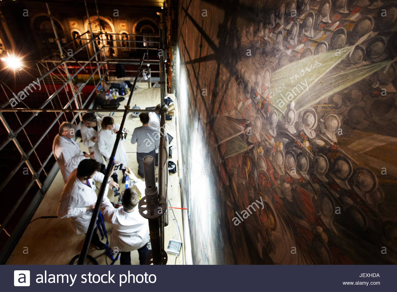 Restorers and scientists from UCSD work on a platform while looking for the lost Leonardo da Vinci mural 'The - Stock Image