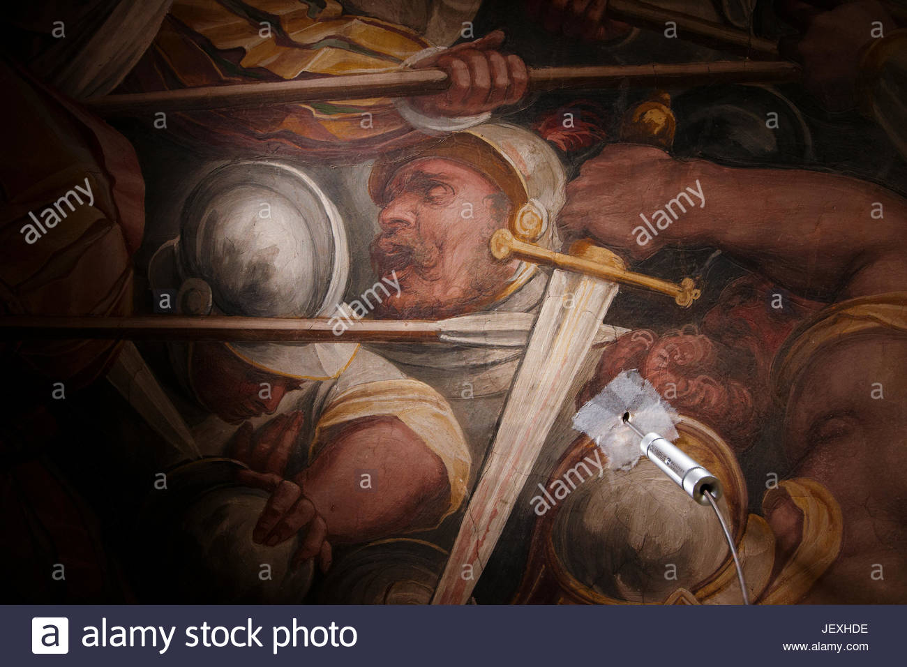 An endoscope is passed through a hole in a Giorgio Vasari mural made during restoration by the Opificio delle Pietre - Stock Image
