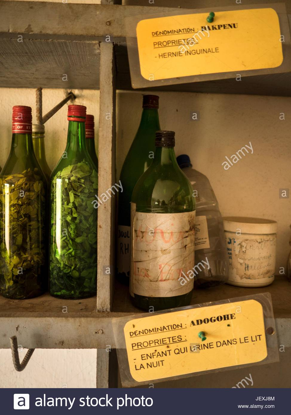 Traditional medicine shop near The Herbal Museum and signs offering cures for hernia and urinary incontinence in - Stock Image
